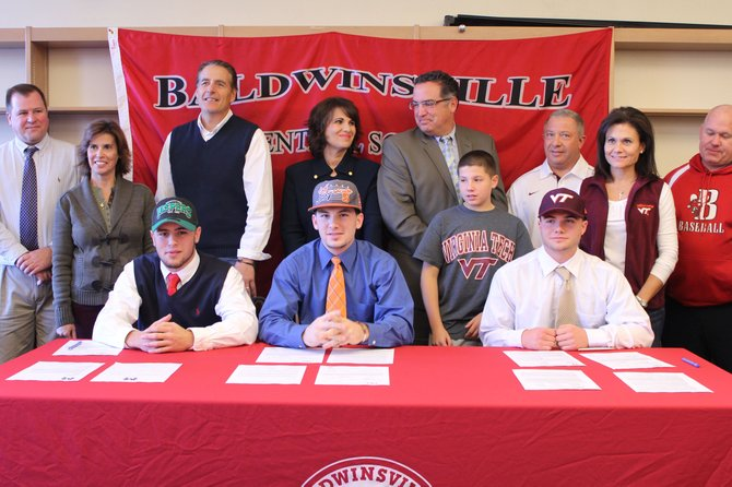 On Nov. 14, three Baldwinsville varsity athletes signed their letters of intent to play lacrosse and baseball for Division I schools. Scott Kirchner, left, will play lacrosse for Manhattan College and his teammate Parker Ferrigan, middle, will play for Syracuse University. Gabe Levanti, right, will play baseball for Virginia Tech. With them are (back row, from left) Bob Kirchner, Christine Kirchner, Peter Fiorini, boys varsity lacrosse coach, Terri Ferrigan, Kevin Ferrigan, Frank Levanti, John Levanti, Karen Levanti and David Penafeather, boys varsity baseball coach.