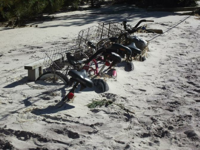 Hurricane Sandy left these bikes on Long Island buried in hard packed sand up to their seats.