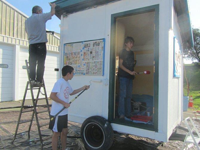 Sam Stone and his volunteers refurbish the Baldwinsville Optimists Christmas Tree Sale hut.