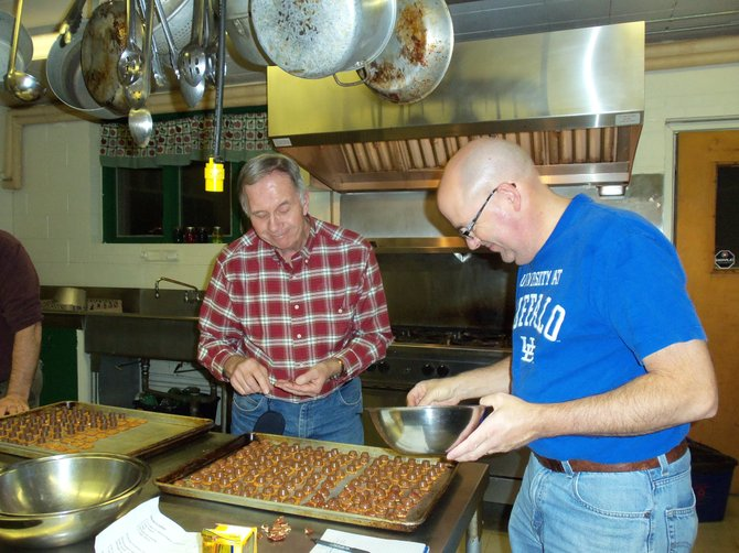 Bruce Haney, left, and Rob Parmele assemble turtles for the cookie walk.