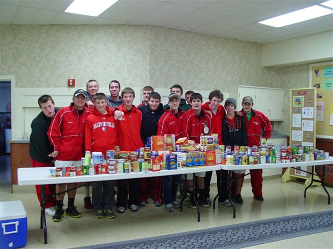 As part of their efforts to support their community, the Baldwinsville Varsity Ice Hockey Team (pictured (front row, from left) Jon Radell, Nick Harper, James Pelcher, Charlie McAllister, Matt Abbott, Dave Mazurkiewicz, Matt Zandri , Matt Monaco, Matt Metcalf, Matt Colclough, (back row, from left) Josh Pinard, Ronnie Bertrand, Mike Schneid, Jeremy Cook and Dave Marsell) conducted a food drive recently in Baldwinsville to benefit the food pantry at the First United Methodist Church in Baldwinsville, which is part of the area Food Pantry program and serves more than 150 families each month. 