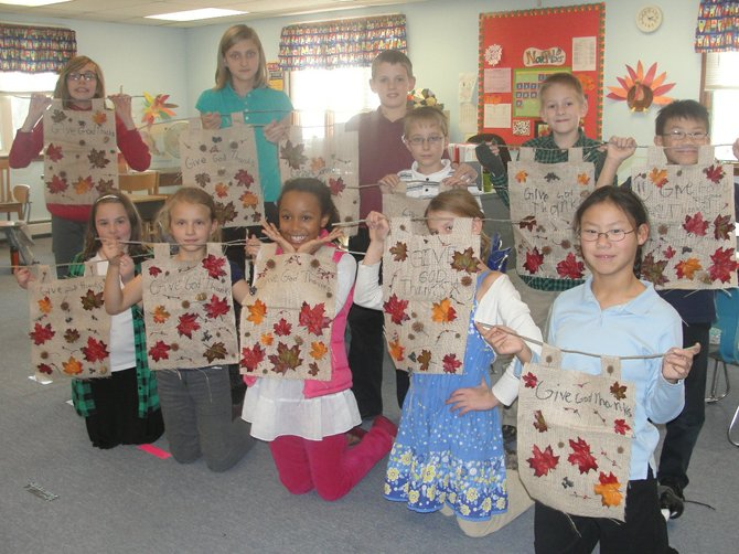 Mrs. McCarthy's fourth and fifth graders at Baldwinsville Christian Academy celebrate Thanksgiving with crafted banners. Another reason for all the smiles is the school is celebrating their 40th year of service after being founded by Faith Baptist Church in 1972.