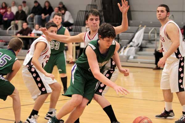 Austin Williams, center, plays hard against Crown Point in a game last season. He is expected to be a team leader. Hes probably going to be our heart and soul this year, said Coach Glenn Lang. The Mountaineers begin their season with a Dec. 4 game in Crown Point against the Panthers.