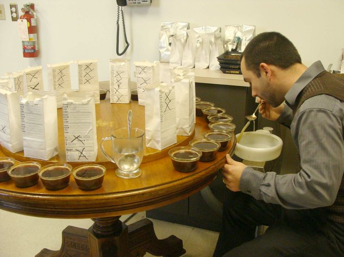 "Dan May, of Brewerton, in the Paul de Lima ""cupping"" room, where he taste-tests coffee. This Syracuse original was started in the early 1900's when a woman from Syracuse brought home green coffee beans from Brazil."