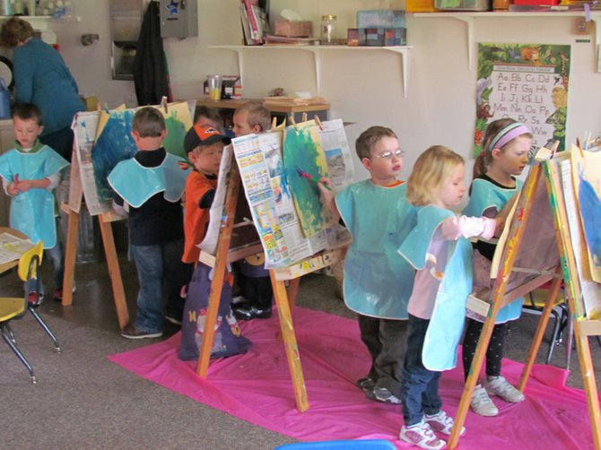 Radisson Nursery School 4-year-olds recently expressed themselves by painting to music.