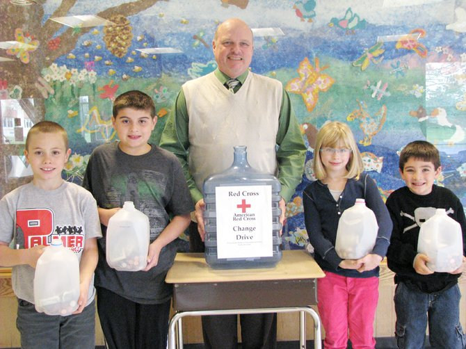Tom Czajak, a representative with the American Red Cross, recently visited the school to accept the donation from students (from left) Luke St. Onge, Adam Graham, Emilia Blasiak and Damien Colan.
