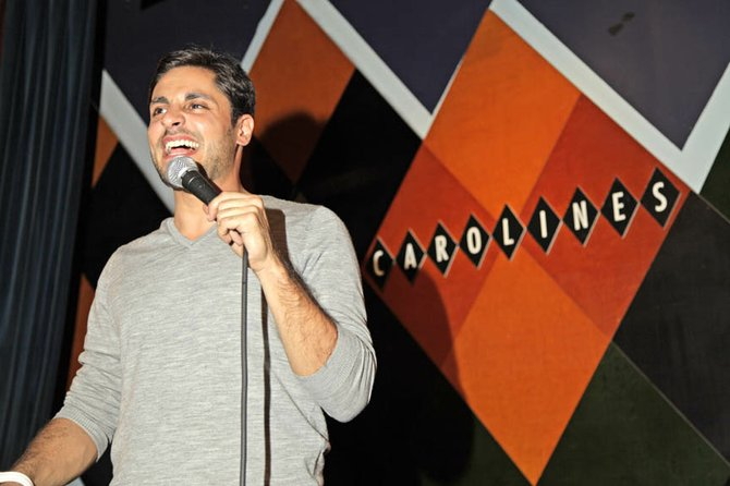 Baldwinsville Alum Dan Frigolette performs stand-up comedy this past October at Caroline&#39;s Comedy Club in New York City.
