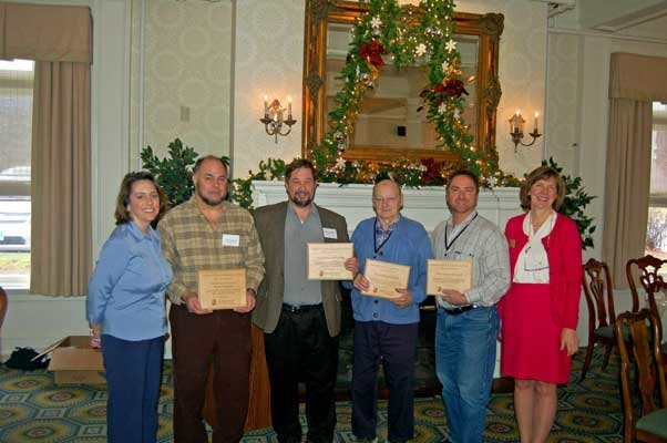 Addison County Companies to Watch Awards recipients: (L-R) Darcy Tarte, ACEDC Board President; Tommy Lathrop, Exclusively Vermont Wood Products; Robin Ingenthron, Good Point Recycling; Dorris Fournier, WhistlePig Whiskey; Louis Prue, Tata Harper Skin Care; Robin P. Scheu, ACEDC.
