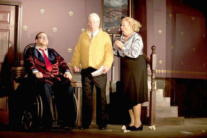 "Actor Tom Minion (center), who lives in Liverpool, portrays Mr. Stanley, while Jim Uva portrays wheelchair-bound radio wit Sheridan Whiteside (left) and Cathy Greer-English plays Mrs. Stanley (right) in the CNY Playhouse production of ""The Man Who Came to Dinner,"" now playing at Shoppingtown Mall in DeWitt, at 8 p.m. Thursday, Friday and Saturday, Dec. 20, 21 and 22, and closes at 2 p.m. Sunday, Dec. 23. Tickets cost $20 for the show only, or $34.95 for dinner and show at Friday and Saturday performances; 885-8960; cnyplayhouse.com."