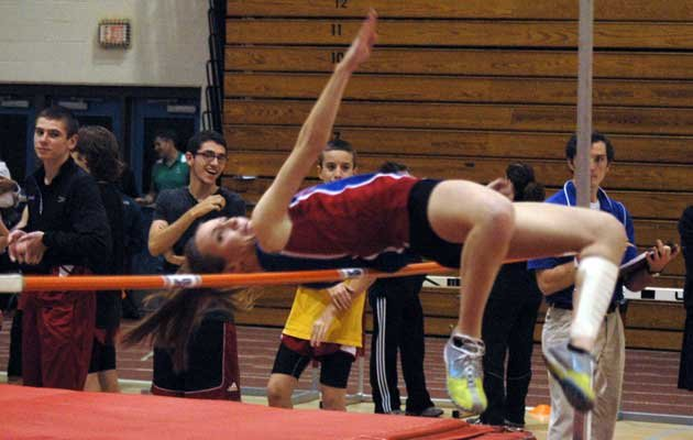 Ashlee Estes competes in the high jump for AuSable Valley.