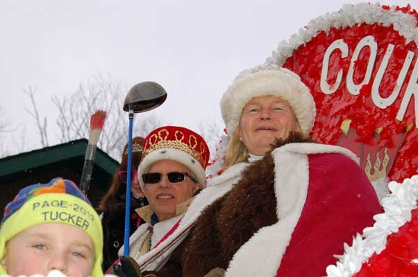 2012 Saranac Lake Winter Carnival King Tim Fortune and Queen Kelly Morgan ride atop the royalty float during the Gala Parade.