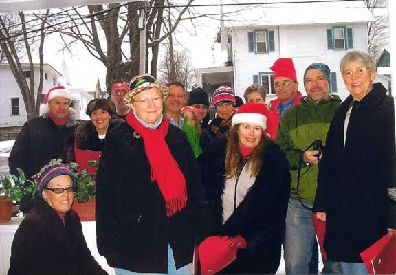 About two dozen Bolton residents take a break from singing Christmas carols Sunday, Dec. 16 to share their smiles with Adirondack Journal readers.