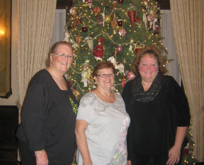 Baldwinsville's Candace Edwards, right, recently helped lead a team of women to decorate the General Federation of Women's Clubs Headquarters building in Washington D.C. with an authentic Victorian theme. With her are Karen Morris, left, of Liverpool, and Nancy Hamilton, of Baldwinsville, standing before the Victorian holiday tree they decorated, which features ornaments from GFWC clubs across the country.