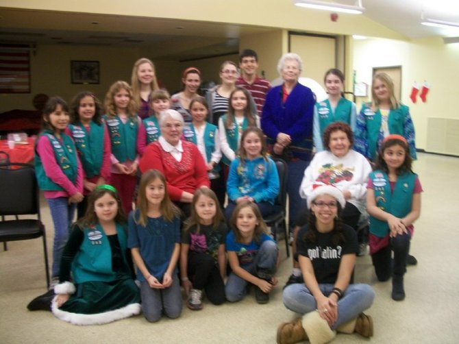 As part of her Girl Scout Gold Award project, Baker High School Senior Della Patterson (front right) organized a holiday sing along at Canton Woods Senior Center recently.