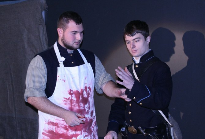 William DeSain, left, plays the part of a Union doctor examining a potential recruit played by Andrew King.