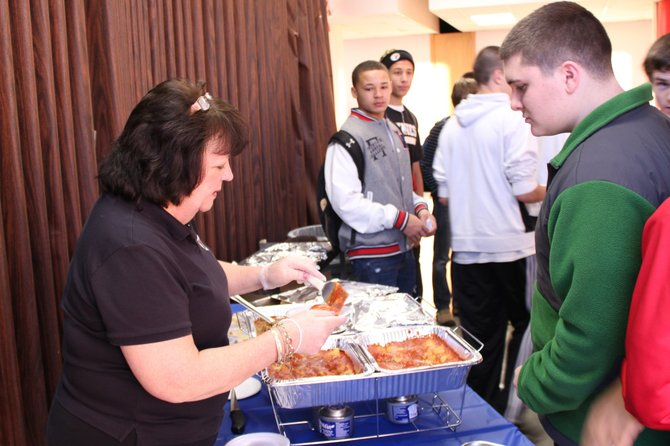 Students sample vegetable lasagna during Baker High School's wellness day.