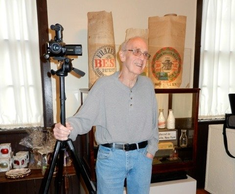 Public Access Channel – Baldwinsville volunteer cameraman Colin Kahl takes a break from taping a recent Remembering Baldwinsville program hosted at the Museum at the Shacksboro Schoolhouse.