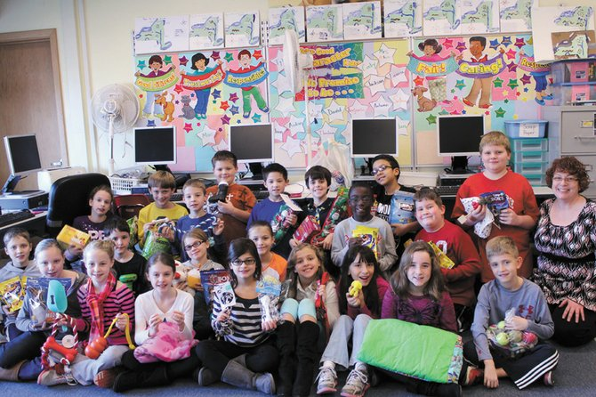 Instead of having a holiday party this year or exchanging gifts, fourth-graders in Mrs. Sue Allen's class at McNamara Elementary School concentrated their efforts on collecting items for the CNYSPCA to make the season brighter for some furry friends and to support the organization's efforts to care for the animals it shelters.