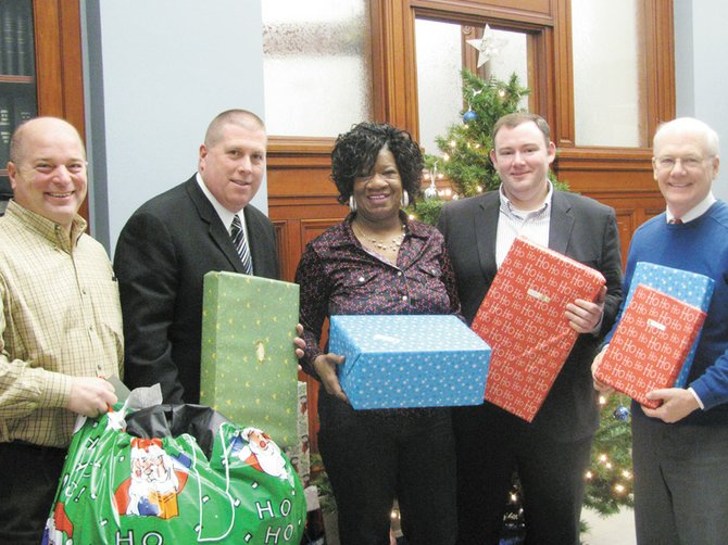 "Onondaga County Legislature's Health Committee members (from left) Casey Jordan, Danny Liedka, Monica Williams, Van Buren representative Derek Shepard and Bill Meyer drop off gifts to their ""adoptive"" families at Elmcrest Children's Center on Salt Springs Raod in Syracuse."