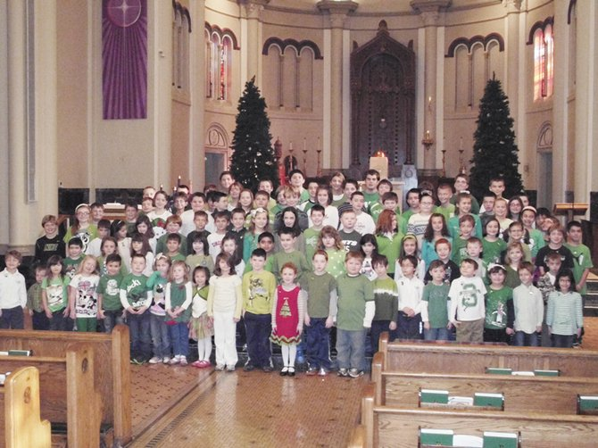On Thursday, Dec. 20, the children of St. Mary's Academy showed their support for the families of Newtown, CT, and honored those who tragically lost their lives by wearing green and white, the school colors of Sandy Hook Elementary School, as well as a green ribbon with a gold angel on it.