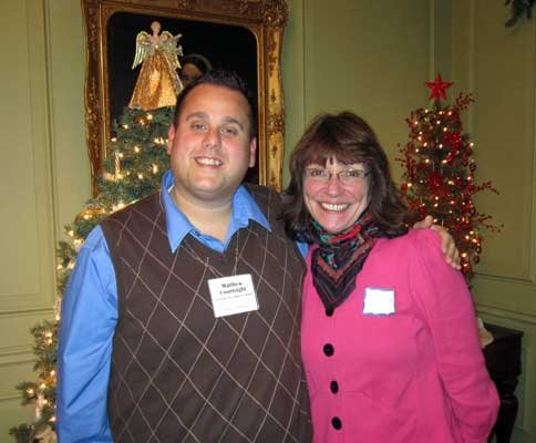 Matt Courtright, from the Ticonderoga Area Chamber of Commerce, and Suzanne Maye, from the Lake Champlain Region Visitors Center, visit at the chamber's December After Business Mixer at the Hancock House in Ticonderoga.