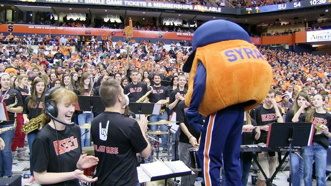 Syracuse University mascot Otto the Orange steps in to conduct the Baldwinsville Plan Bee Pep Band when the band performed as the house band for the Syracuse University men's basketball game Dec. 17.
