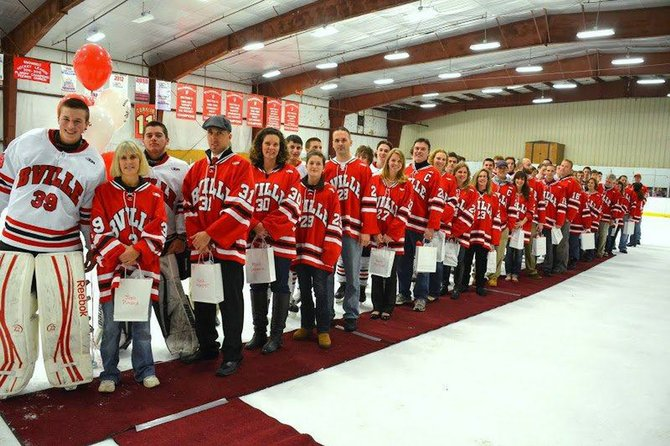 Members of the Baldwinsville varsity ice hockey team are joined by their most inspirational teachers on the ice at the team's home game on Dec. 4.
