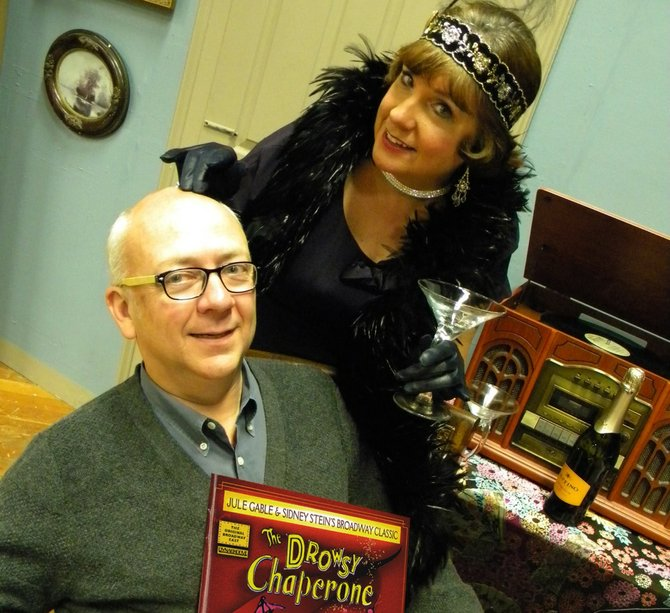 "Mark Baker, as ""Man In Chair,"" and Kathy Egloff, as ""The Chaperone,"" rehearse for the Baldwinsville Theatre Guild's upcoming production of ""The Drowsy Chaperone,"" which opens at 8 a.m. Jan. 18 at the Presbyterian Education Center, 64 Oswego St., Baldwinsville."