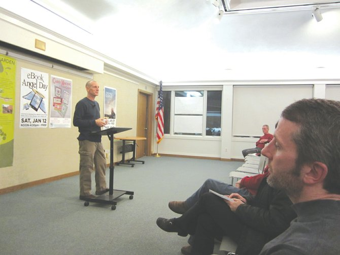 """Spiritual teacher John Bruna, formerly a Buddhist monk, spoke to those gathered in the Carman Community Room Thursday, Jan. 10. He encouraged his audience to achieve personal happiness by pursuing what he called """"universal wisdom."""""""