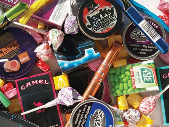 "Tobacco marketers often package their products to look like candy, as shown here, drawing in kids as ""replacement smokers"" for adults who have either quit or died of tobacco-related disease."