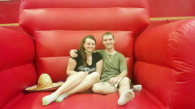 Baker High School Class of 2012 graduates Caitlin Kurilovitch and Travis Pancioli sit in the bounce house during last year's Keep the Ball Rolling celebration, which not only focuses on providing seniors a night of outrageous fun but, more importantly, gives seniors a way to celebrate without alcohol, drugs and driving thus helping to prevent tragic accidents on Senior Ball night.