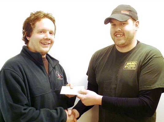 JD Davis from AuSable Forks (left) receives a $250 Ward Lumber gift card from Travis Thwaits of Ward Lumbers Jay store.