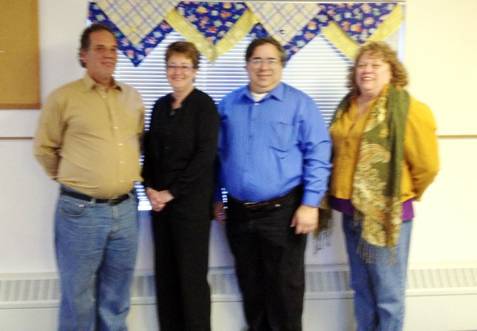 (From left) Brendan Ryan, Ellen Stevens, Mike Adao and Elaine Sartwell, members of the local organization B'ville CARES, invite qualifying residents to take advantage of a new program offering free income tax preparation.