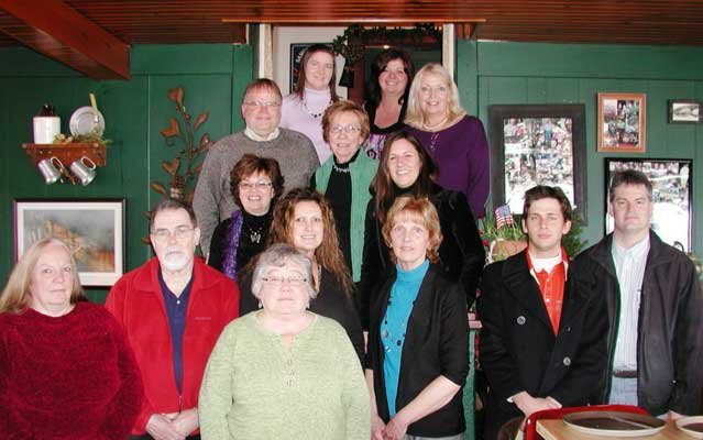Peg Shaw was recently recognized by Fort Ticonderoga staff for her years of service. Joining Shaw, front center, are Debbie Jordan, Bob Bartlett, Nancy LaVallie, Cathy Burke, Stuart Lilie, Chris Fox, Mimi Treadway, Beth Hill, Rich Strum, Dorcey Crammond, Sharon Burstein, Martha Strum and Kari Bruce.