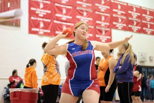 Michaela Courson competes in the shot put event for the AuSable Valley Lady Patriots indoor track team.