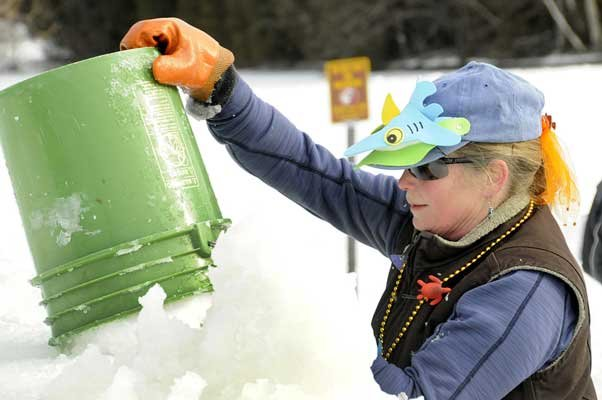 Palace Build - Pat Carnell applies slush mortar to the Saranac Lake Winter Carnival Ice Palace Saturday, Jan. 26 during the first day of construction. The Winter Carnival runs from Feb. 1 to 10, and the lighting of the Ice Palace will be held at 7 p.m. Saturday, Feb. 2.