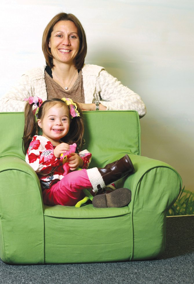Ally Donofrio, founder of the Cicero area Gigi's Playhouse, and her daughter Addison were featured in the February 2013 edition of Syracuse Woman Magazine.