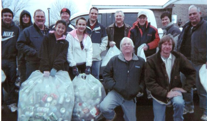 Helping to collect bottles and cans for the benefit of the Baldwinsville Christmas Bureau are (back row, from left) Nathan Morrow, Kyle Shepard, Derek Shepard, Matt Morrow, Bob Fancher, John O'Neill, Eric Porter, Tim Holtman, (front row, from left) Derek Shepard, St., Marie Henwood, Nicole Morrow, Steve Sloan and Mike Smith. Missing from the photo, but not from the effort, are Lisa Shepard Morrow, Phil and Mary Lou Bender, Ann Dennis, Tim Nobles and Cindi Segovis. Members of Grace Episcopal Church and Nobles Tire City also contributed as did Edward Ledwith.