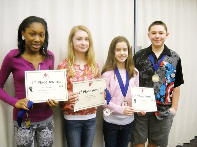 (From left) Adriana Straughter, Abigail Scherfling, Kaitlyn Devine, and Kellen Albrecht, students at Ray Middle School, have advanced to the state portion of the National PTA Reflections art program. Missing from the photo is Hannah Pinard.