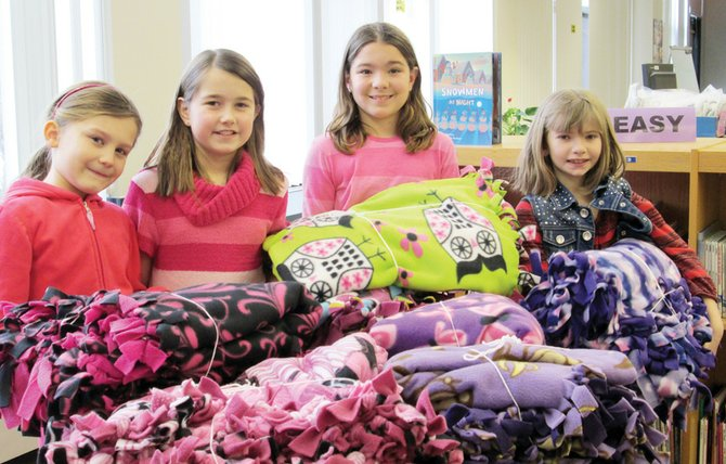 Reynolds Elementary School third graders (from left) Maria DeCaro, Brianna Kennedy, Abigail Toland and Sydney Hall started Blankets for Breast Cancer at the school to support breast cancer patients.