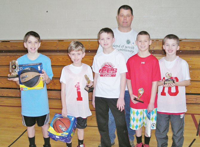 Optimist Paul Hunt stands behind last year's winners in the Baldwiinsville Optimist Club foul shooting contest for contestants less than five feet tall. This year's contest will be held March 9.
