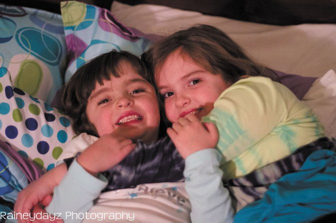 """Maggie, 7, left, and her sister, Abigail, 9, embrace each other before talking about what has become a lifelong conversation — heart disease. Maggie was born with an underdeveloped left ventricle. In layman's terms, it's known as having a """"half of a heart""""."""