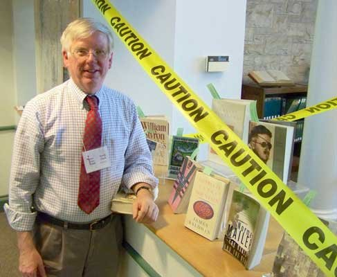 Ilsley Public Library Director David Clark will retire next month. He will discuss his tenure during a StoryMatters session in Middlebury Feb. 26. Pictured: Clark stands beside a display of banned books in 2010.