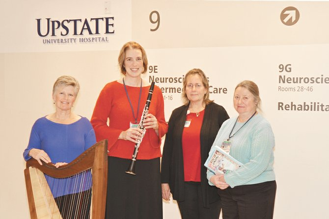 Laura Jordan, of Baldwinsville, Victoria Krukowski of Cicero, Libby Joyce of South Onondaga and Mary Tolone of Mattydale, are among the first class of students in Upstate's Music for Health and Transition Program. To fulfill their certification requirements, they will play for patients at area healthcare institutions.