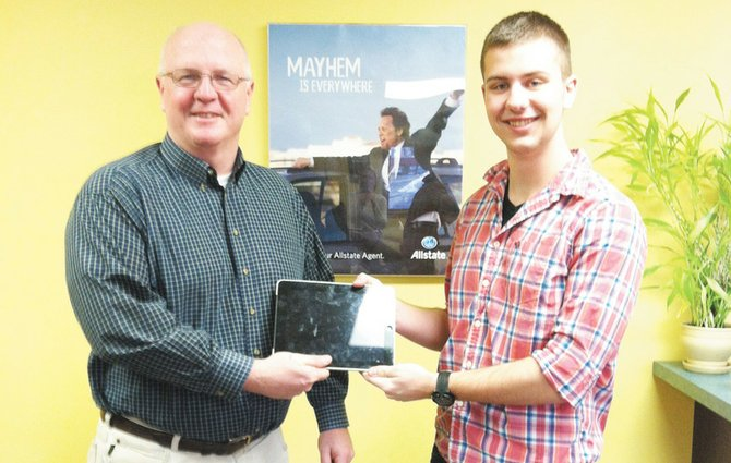 Chris Hayden, of Allstate Insurance in Baldwinsville, presents Matt Noll, right, with an iPad III, a donation for this year's Keep the Ball Rolling event scheduled for May 24.