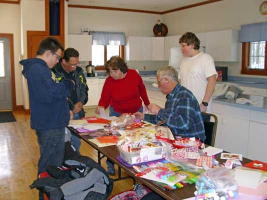 A few Thurman residents gathered last week at the town hall to create valentines for veterans. Among those working to spread cheer among soldiers who served our nation, were Bob Shepler  (right front) and his grandchildren Robert and Colby, along with Andy Templeton (left rear) and Myrna Keeler (right rear).