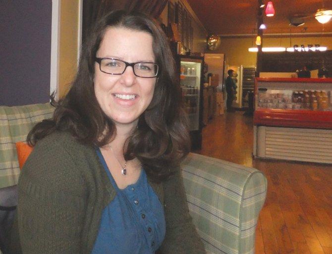 "Sarah Alamond, author of the ""Life in Liverpool"" blog, sits at Café at 407."