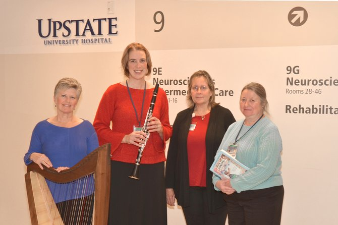 From left, Laura Jordan of Baldwinsville, Victoria Krukowski of Cicero, Libby Joyce of South Onondaga and Mary Tolone of Mattydale are among the first class of students in Upstate's Music for Health and Transition Program. To fulfill their certification requirements, the will play for patients at area healthcare institutions.