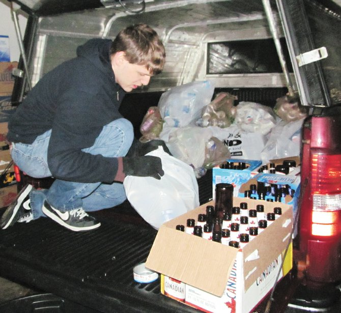 Brandon Hart empties out a truck full of bottles and cans collected this past Saturday. Proceeds from the fundraiser will help offset costs of Hart's Eagle Scout project, which is to place a monument at the Hardscrabble Cemetery in Van Buren.