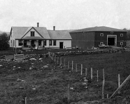 The Symes family farm house and barn, circa 1895.